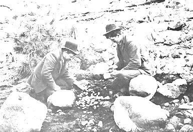 Old photograph of miners with coins